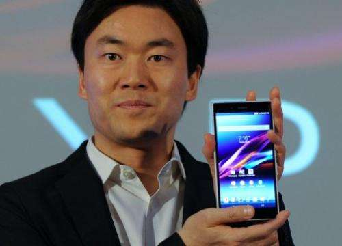 Tadato Kimura displays the Xperia Z ultra waterproof smartphone in New Delhi on July 30, 2013