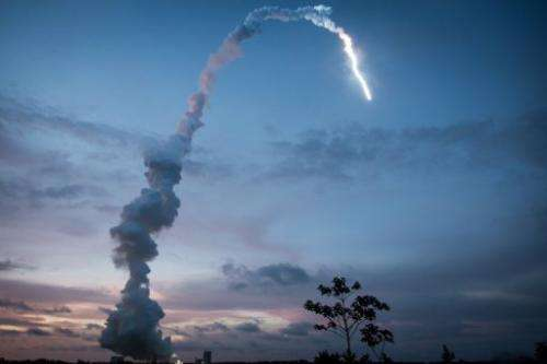 The Ariane 5 blasts off from the ground at the French Guyana European Spaceport of Kourou on June 5, 2013