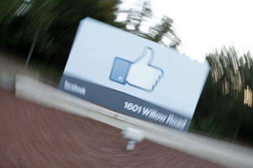 The Facebook's Like Button logo displayed at the entrance of the Facebook HQ in Menlo Park, California on May 18, 2012