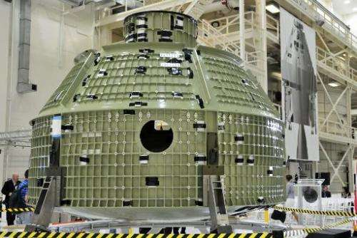 The first flight shell of NASA's new Orion spacecraft is presented to invited guests and the media inside the Operations and Che
