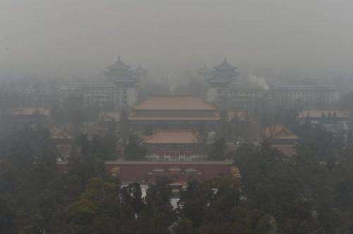 The Guotai Chambers building from the historic Jingshan Park as smog continues to shroud Beijing on January 31, 2013
