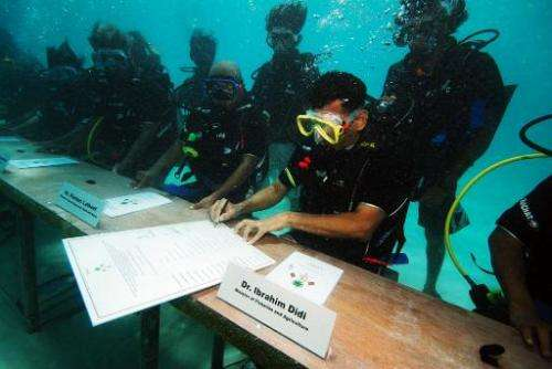 The Maldives government holds a cabinet meeting under water on October 17, 2009 to highlight the threat of rising sea levels