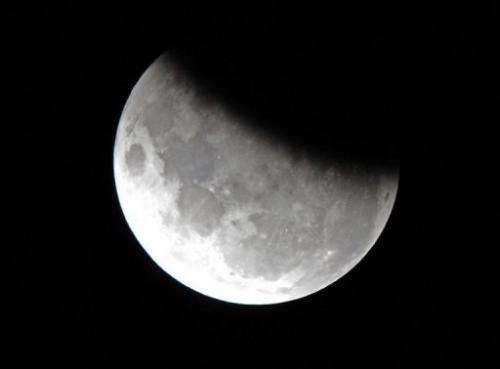 The moon is 37 per cent obscured by the Earth's shadow during the partial lunar eclipse above Sydney on June 4, 2012