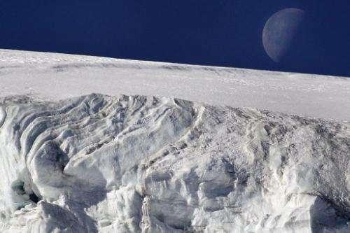 "The moon seen above the ""Feegletscher"" in Switzerland on November 1, 2007"