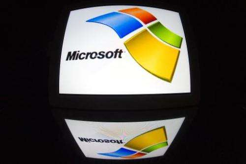 """The """"Microsoft"""" logo is seen on a tablet screen on December 4, 2012 in Paris"""