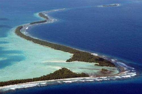 The South Pacific pounds the serpentine coastline of Funafuti Atoll, February 19, 2004