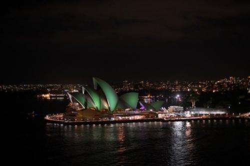 """The Sydney Opera House shortly after the start of the annual """"Earth Hour"""" on March 23, 2013"""