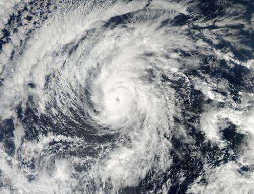 This October 27, 2013 NASA satellite image shows Hurricane Raymond churning in the Pacific Ocean off Mexico