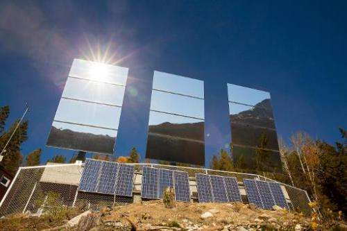 Three giant mirrors errected on the mountainside above Rjukan, Norway, reflect sunshine towards the center of the town, on Octob