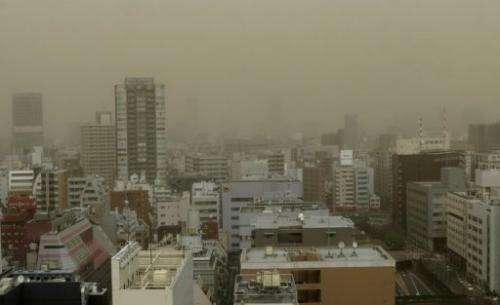 Tokyo's Ginza shopping district is hit by a dust storm on March 10, 2013
