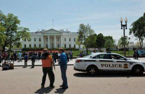 Tourists are pictured outside the White House in Washington DC on April 24, 2013
