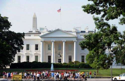 Tourists gather in front of the White House in Washington, DC, on June 15, 2009
