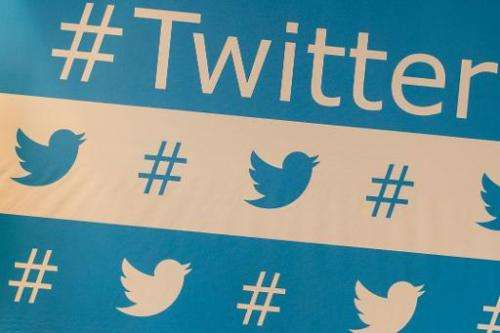 Twitter's brand marks are seen as of the speakers during their press conference in Sao Paulo, Brazil on Februrary 20, 2013