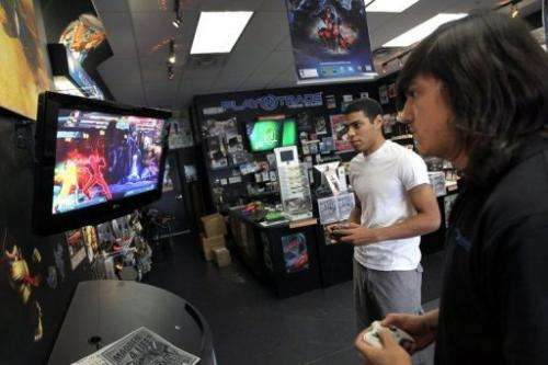 Two men plays against each other in a violent game at a store in Miami, Florida, on June 27, 2011