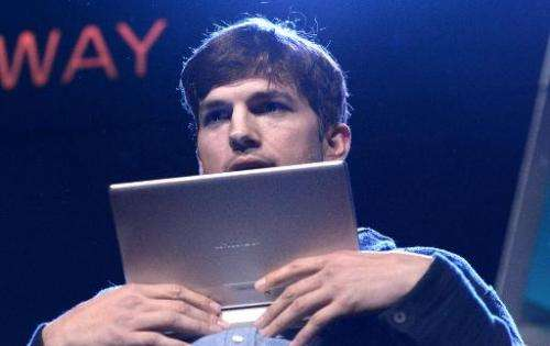 US actor Ashton Kutcher presents Lenovo's first multi mode Yoga Tablet on October 29, 2013 in Los Angeles