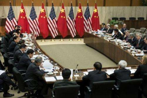 US Deputy Secretary of State William J. Burns (lower R) and other officials meet with Chinese counterparts