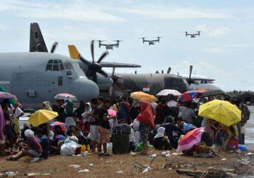 US Marine Osprey aircraft arrive to deliver aid at Tacloban airport after Typhoon Haiyan hit the east coast of the Philippines,