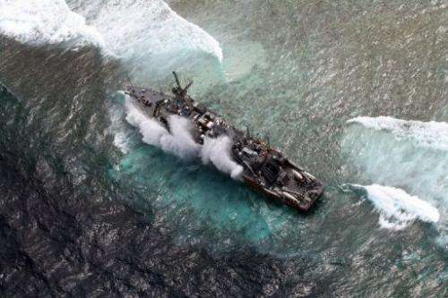 US Navy minesweeper, the USS Guardian, pictured as it remains trapped on the Tubbataha Reef, on January 19, 2013