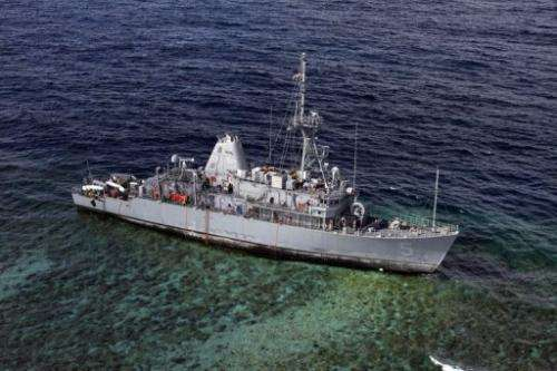 USS Guardian warship sits aground on the Tubbataha Reef in the Sulu Sea, on January 22, 2013