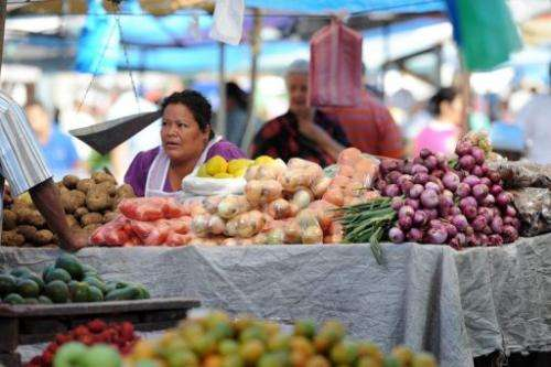 Vendors sell fruits and vegetables at the El Mayoreo street market in Tegucigalpa on October 6, 2012