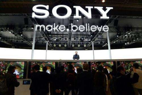 Visitors gather at the Sony booth during a show in Yokohama, on January 31, 2013
