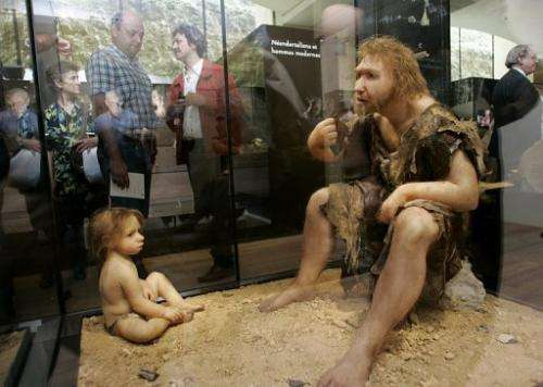 Visitors of a museum in Eyzies-de-Tayac look at a Neanderthal man ancestors' reconstructions, on July 19, 2004