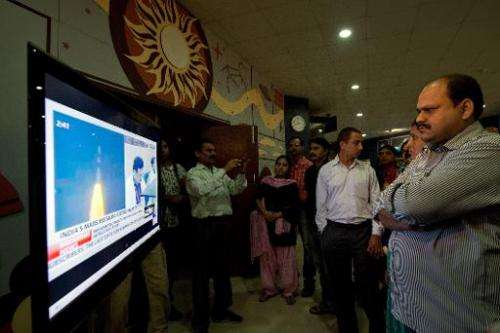 Visitors to the Nehru Planetarium watch the live telecast of the launch of India's Mars Orbiter Mission, in New Delhi, on Novemb
