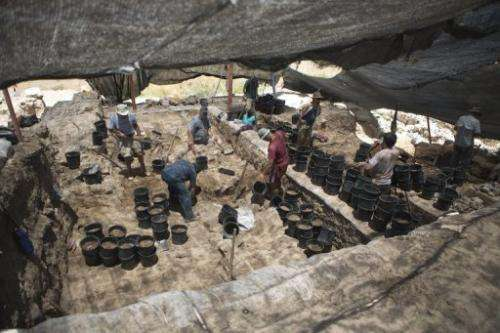 Volunteers from Hebrew University work at an excavation at the Israeli archeological site of Tel Hazor, on July 9 2013