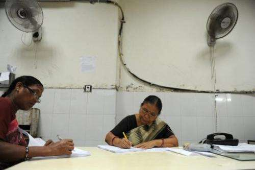 Workers go about their business at the Central Telegraph Office in New Delhi on July 10, 2013