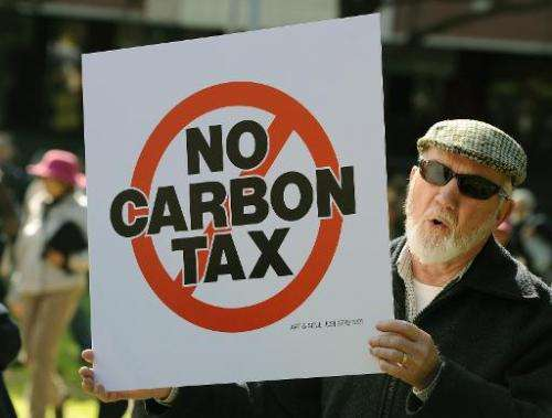 A demonstrator shouts slogans during a protest against a carbon tax in Sydney on July 1, 2012