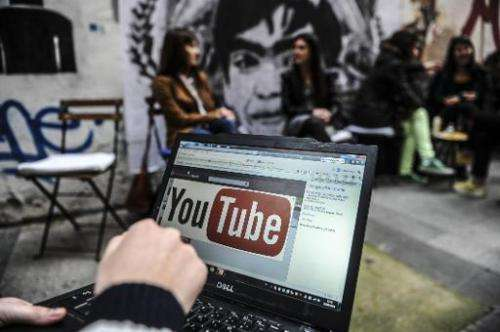 A man looks at the YouTube site on a laptop in Istanbul, on March 27, 2014