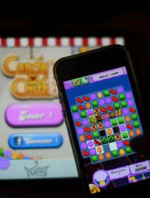 A man plays at Candy Crush Saga on his Iphone