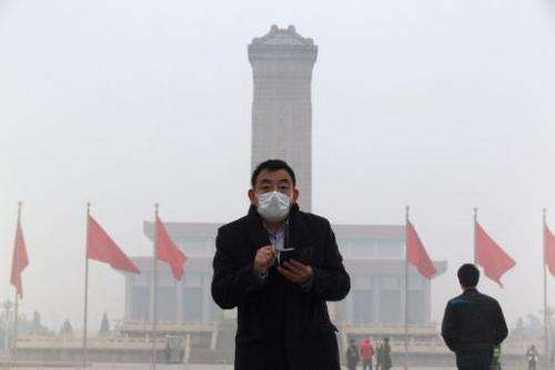 A man walks through a haze-shrouded Tiananmen Square  in Beijing on February 23, 2014