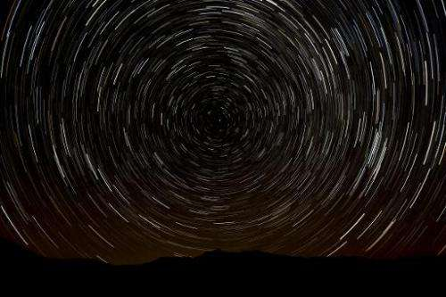 A multiple exposure picture taken in the early hours of August 11, 2013 shows a Perseids meteor shower in the sky, near the muni