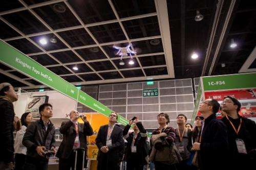 An exhibitor flies a drone at the 40th Toys and Games Fair in Hong Kong, on January 8, 2014
