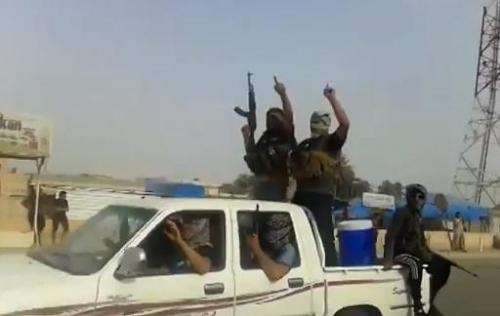 An image grab taken from a video uploaded on Youtube on June 17, 2014, allegedly shows militants from the Islamic State of Iraq