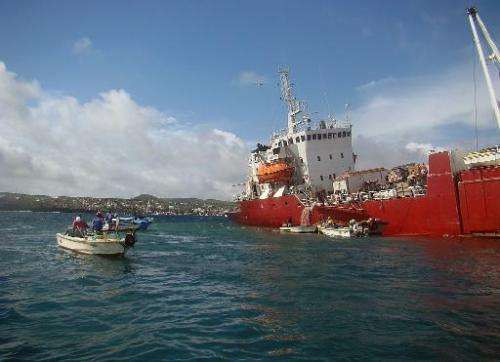 A picture released by Galapagos National Park shows an Ecuadoran freighter which ran aground on May 9, 2014 off the island of Sa