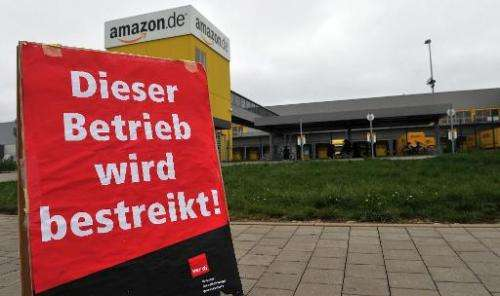 "A sign reads ""this site is on strike"" in German in front of the logistics center of US online retailer Amazon in Grabe"