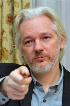 Assange talks of leaving embassy, sowing confusion