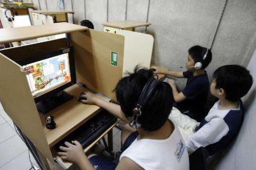 Children playing computer games in Singapore, on December 28, 2006