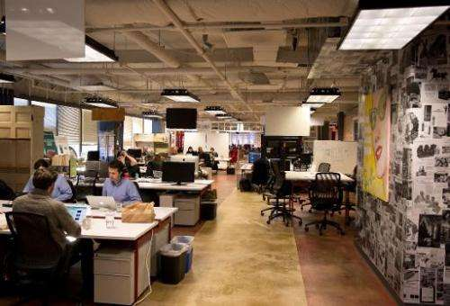 Employees of start-up companies work at their designated spaces at the offices of 1776 business incubator in Washington DC, Febr