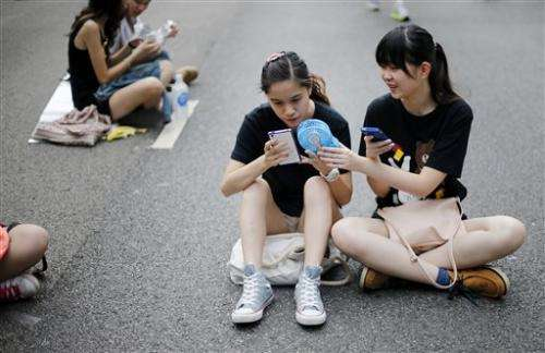 Firm says phone apps spy on Hong Kong protesters