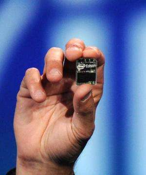 """Intel Corp. CEO Brian Krzanich introduces """"Intel Edison,"""" a tiny Intel-based computer, during his pre-show keynote add"""