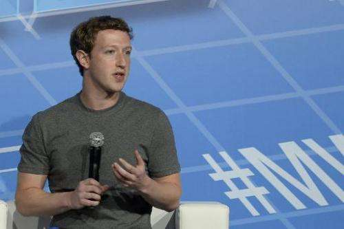 In this February 24, 2014 photo Facebook's creator Mark Zuckerberg speaks on the opening day of the Mobile World Congress in Bar
