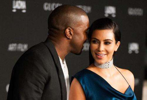 Kim Kardashian and her husband, recording artist Kanye West, pictured in Los Angeles on November 1, 2014
