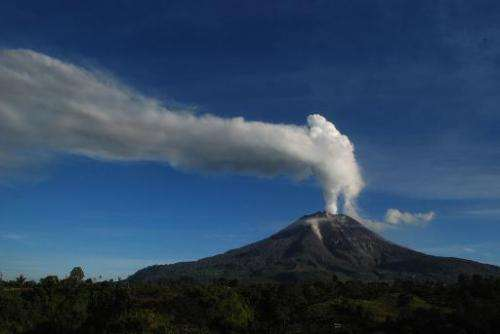 Mount Sinabung volcano as smoke and ash fill the air, in the Karo district of Sumatra island on August 14, 2014