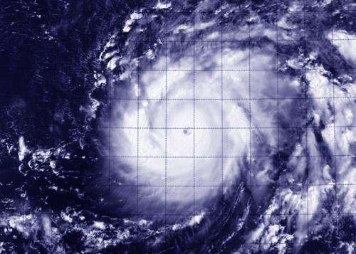 NASA sees Genevieve cross international date line as a Super-Typhoon