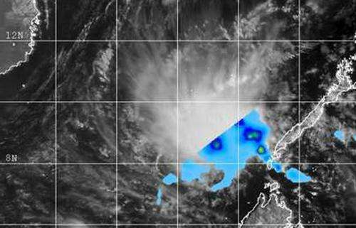 NASA sees remnants of TD04W dissipating in South China Sea