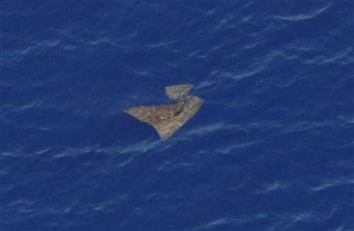 Ocean garbage frustrates search for Flight 370