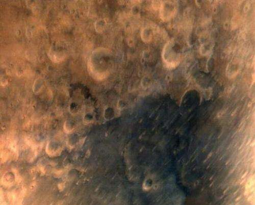 One of the first images taken by the ISRO Mars Orbiter Mission spacecraft, released on September 25, 2014, shows the surface of